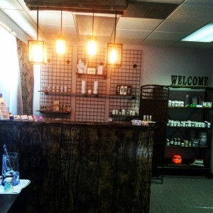 The front desk area featuring refurbished and recycled wood fixtures